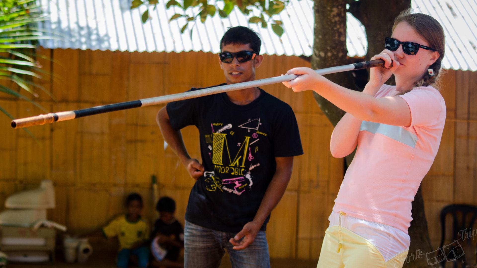 blowpipe, girl blowing blowpipe, aborigine weapon, asli weapon