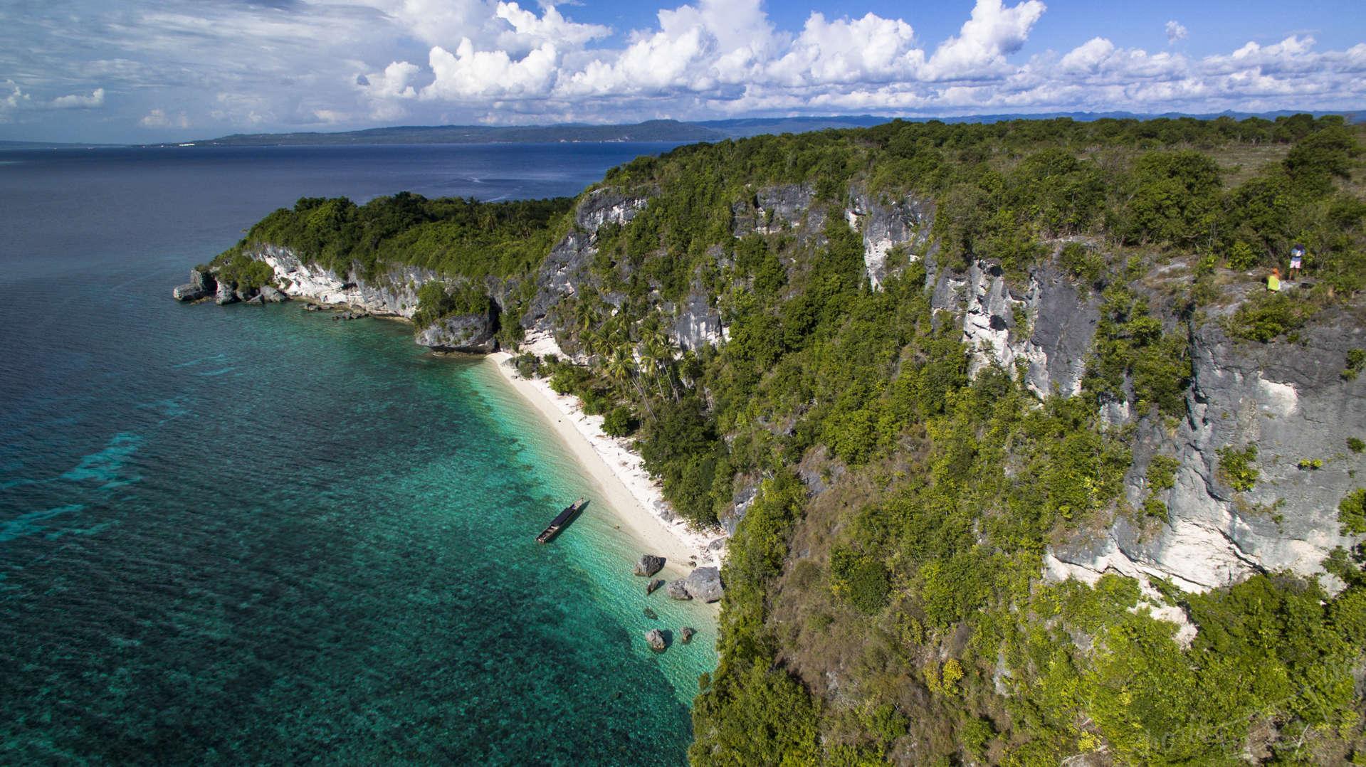 uninhabitat island indonesia, secret island indonesia, white beach secret island drone, drone indonesia
