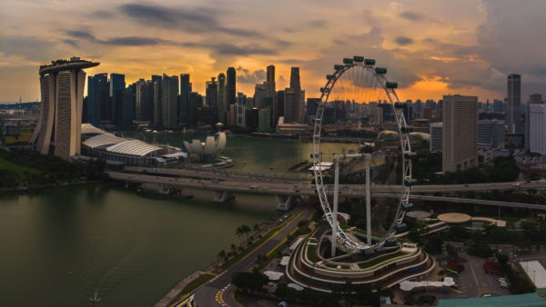 aerial view on Singapore Flyer, drone singapore, drones singapore, singapore aerial, singapore flyer drone, singapore flyer, singapore downtown sunset, singapore downtown drone, aerial view of marina bay sands, marina bay sands sunset singapore, where to fly drone at singapore, singapore drone guidelines, best drone places singapore, singapore laws, singapore regulations