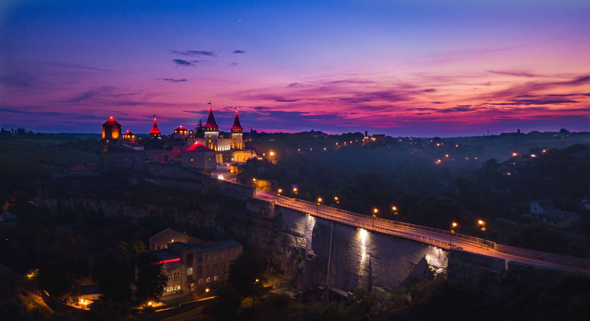 Kamianets-Podilskyi Castle, Kamianets-Podilskyi Castle sunset, Kamianets-Podilskyi Castle backpacking, Kamianets-Podilskyi Castle best photo, Kamianets-Podilskyi Castle tent, Kamianets-Podilskyi Castle wild camping, Kamianets-Podilskyi, best sunset picture, sunset over castle, sunset ukraine, ukraine wild camping, ukraine travel, ukraine backpacker, seven wonders of ukraine, shorts-trip, Kamianets-Podilskyi Castle drone, aerial view of Kamianets-Podilskyi